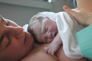 Skin to skin bonding global freedom movement childbirth caesarean section Robbie Floyd Davis Rituals of American Hospital Birth